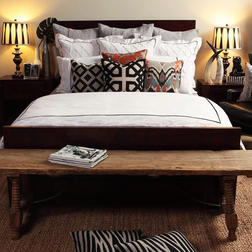 Bold pillow patterns mix well with animal prints for an updated look. #pillows #bedroom
