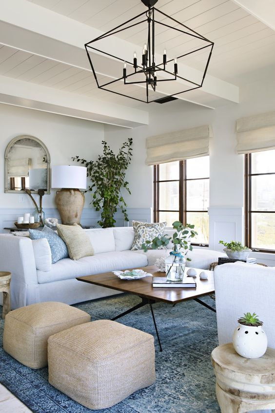 A Chic Coastal Living Room With Touches Of Blue And Light