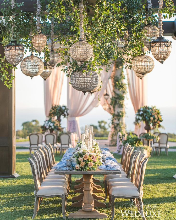 Can you think of a dreamier place to hold a wedding reception? See more on WedLuxe.com (: @jessicaclaire, planner: @agoodaffair, venue: @pelicanhillresort, floral: @bloomboxdesigns, furniture & chandeliers: @rrivre_works, tabletop rentals: @theark_, glassware: @otisandpearl)