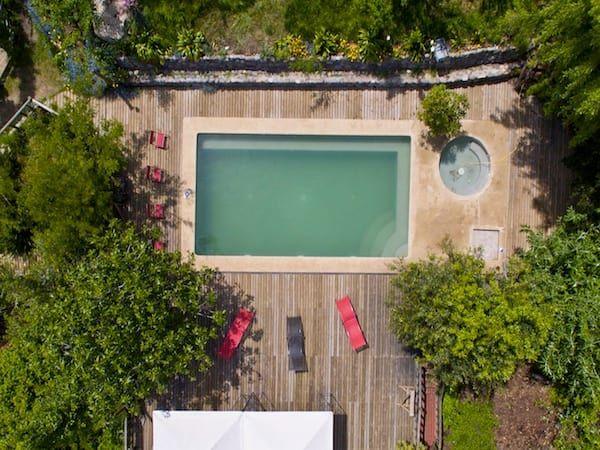 Fotos de piscinas de estilo  : en bosque nativo · cajón del maipo   homify