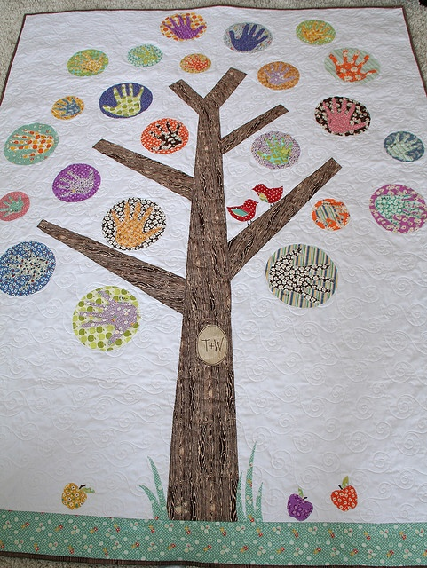 Family tree quilt...inspired by the colors, not so much the handprints.  Love the carved circle too!