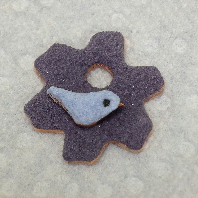 Little bird on flower waiting to go into the kiln.  Bird is Bonnet Blue and the flower is Concord Purple.