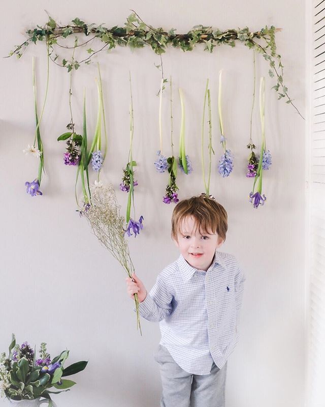 On your marks for the 4m floral relay...get set...go! . Edward thinks of photographs as a game - whats the minimum amount of time he can stay still for while still technically granting my request to stand there for a moment. But he really wants to be on the move. Here he was clutching his sprig of babys breath like a relay racers baton poised to race towards me. . #whpmoveit . The hanging flower decoration was inspired by the tutorial on @kerryvillers blog and made using my Valentines…