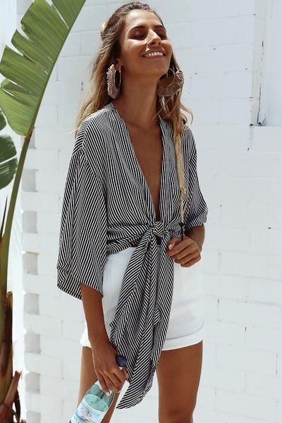 For a simple yet chic vacation look, pair white shorts with a striped tie shirt. Let Daily Dress Me help you find the perfect outfit for whatever the weather! dailydressme.com/