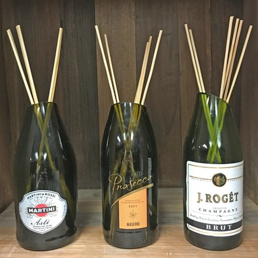 Our M.A.D MINI Diffuser package of re-purposed wine & champagne bottles comes in a package of 12. You will receive a variety of different mini wine & champagne bottles with 6 wood reeds and you can cu