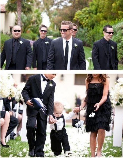 LOVE the all-black groomsmen suits, and the groom distinguished with the white shirt and black tie.