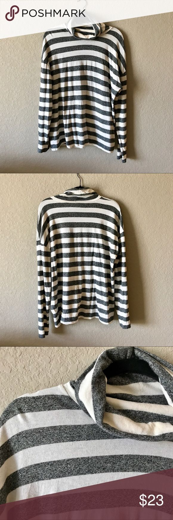"""J. Crew Oversized Grey & White Striped Top J. Crew Oversized Grey & White Striped Top. Great used condition. Slouchy turtleneck style. Very comfortable and perfect to wear with leggings! 24"""" armpit to armpit; 26"""" shoulder to hem. 100% cotton.  ☑️ Bundles (15% off 2+ items) 👍 Open to reasonable offers 🚫 Trades J. Crew Tops"""