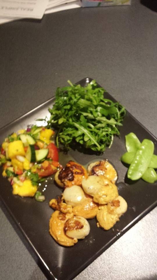 Seared Scallops with Cucumber, Mango Salsa & Rocket n Snow Peas. Recipe on the taste website.