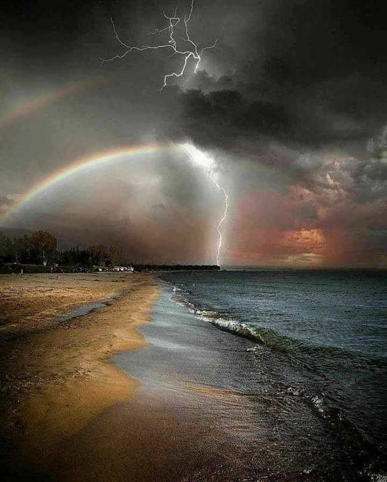 Beach ocean and rainbows and lightning