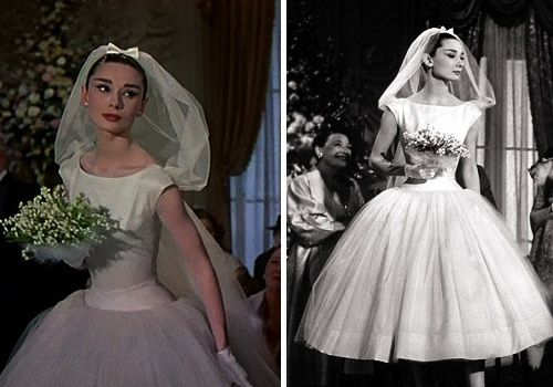 "1957 - Audrey Hepburn in the wedding dress she wore for her role in ""Funny Face."" Created by Givency, the dress is tea length, has a wide bateau neckline, drop waist, and balerina skirt with layers of white tulle."