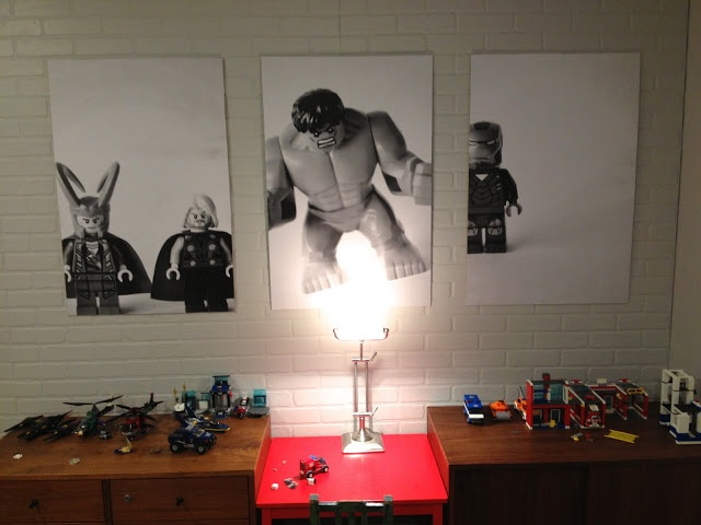 Take photos of your child's favorite toys, print them as engineer prints at copy store ($3/ea), cut off the slight edge, and then measure them exactly.  Go to home store and get thin MDF sheets that are 2'x4' –then have cut there to exact measurements.  Attach the posters with spray adhesive sprayed only on MDF side. Mount with removable 3M Command strips. LOVE!