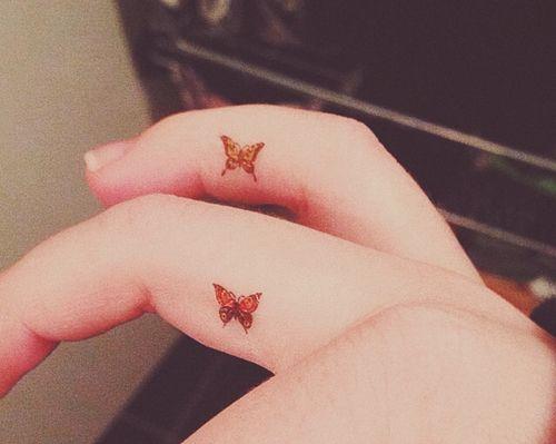 finger butterfly tattoo