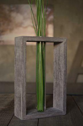 Transparent glass tube vase in grey concrete stand. €25.00, via Etsy.
