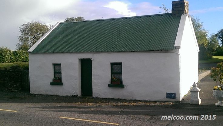 Quaint Irish cottage with a green tin roof located in the village of Abbeylara, county longford, Ireland.