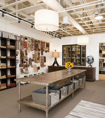 the metal bins, industrial work table, fabric wall....love it all