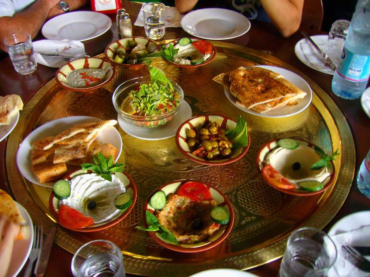 "MEZE (Turkey) Translation: ""Taste"" or ""snack"" Ingredients: A variety of cold and hot vegetables, spreads, and fritters (like hummus, falafel, dolma, eggplant baba ghanoush, etc.)"