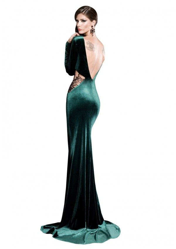 Wearing this elegant green velvet backless evening dress with black lace insertions you will be the woman that has men mesmerized by her beauty.