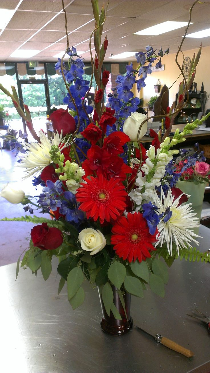 Red, White and Blue Flowers---just in time for July 4th!!  Gerbera Daisy, Blue Delphinium, Roses, Gladiola, Snapdragon, Fujis