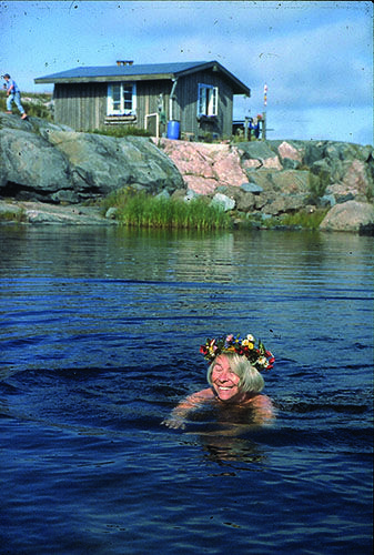 Dreaming of summer. Author and artist Tove Jansson swimming at her Finnish summer house on Klovharu. Photo by Per Olov Jansson.