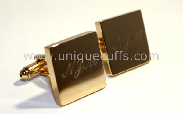 Classic gold engraved cufflinks with the initials of your groomsmen.