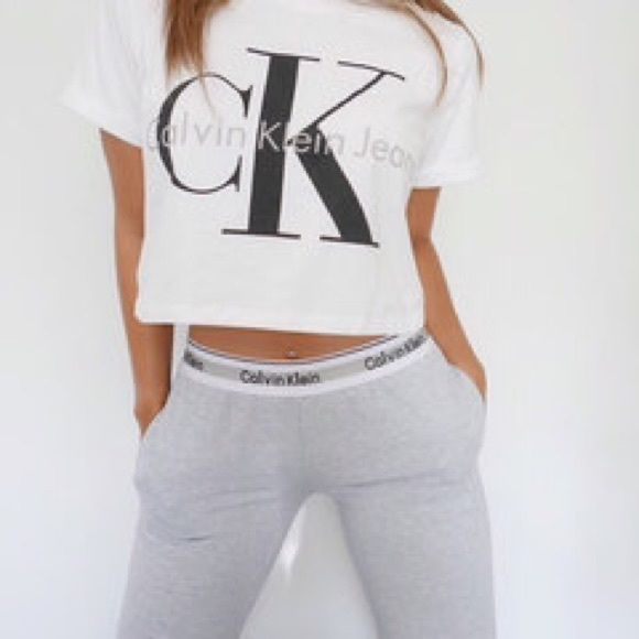Grey Calvin Klein logo leggings and crop tee Says size large but fits like a small or XS Worn once Calvin Klein Pants
