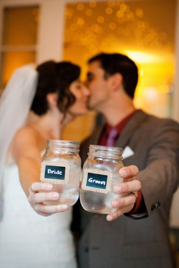 20 things to do with Mason Jars at your wedding: mason jar escort card drinking glasses (photo by jenna danielle)