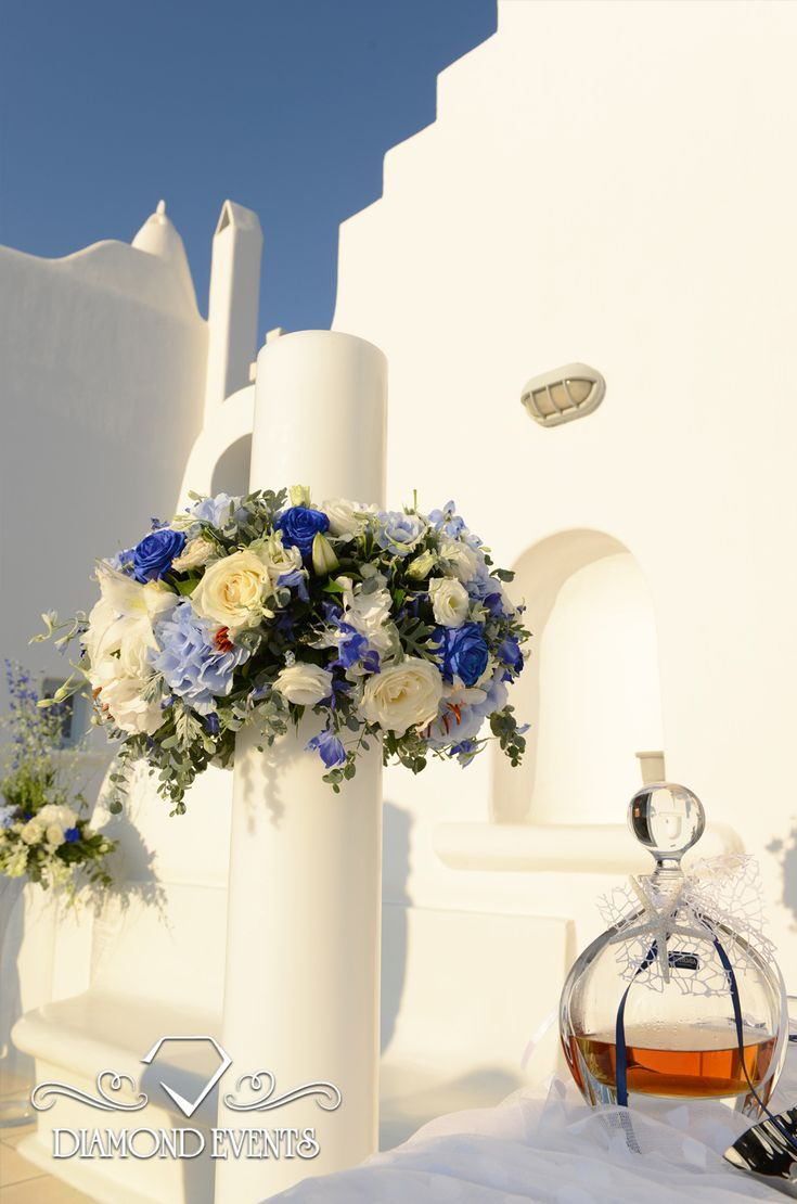 Wedding candles with white and blue flowers in Saint Fotini chapel in Mykonos! For more great ideas visit:  https://www.instagram.com/diamond_event_planners/  https://plus.google.com/u/0/+DiamondeventsGr  https://gr.pinterest.com/diamondwedding/  https://www.facebook.com/Diamond-Event-Planners-176242063682/  http://diamondevents.gr/ #summer #table #tablesetting #tree #unique #vintage #vip #visual_heaven #wedding