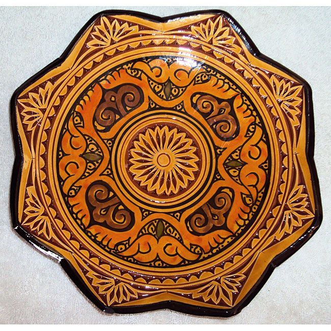 This ceramic engraved plate comes in marigold, green and blue color options. The Isabella plate is made by artisans in Morocco.