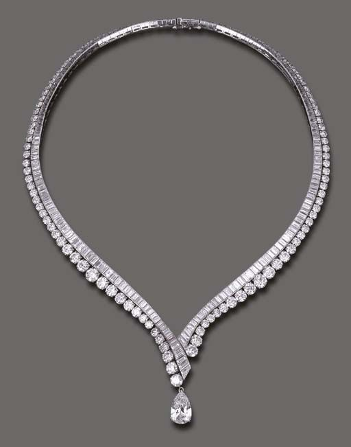 AN ELEGANT DIAMOND NECKLACE, BY VAN CLEEF & ARPELS The flexible V-shaped baguette-cut diamond line, enhanced by graduated circular-cut diamond trim, the front suspending a detachable pear-shaped diamond, weighing approximately 4.11 carats, mounted in platinum and 18k gold, 16 ins., with French assay marks and maker's mark, in a Van Cleef & Arpels blue suede envelope case