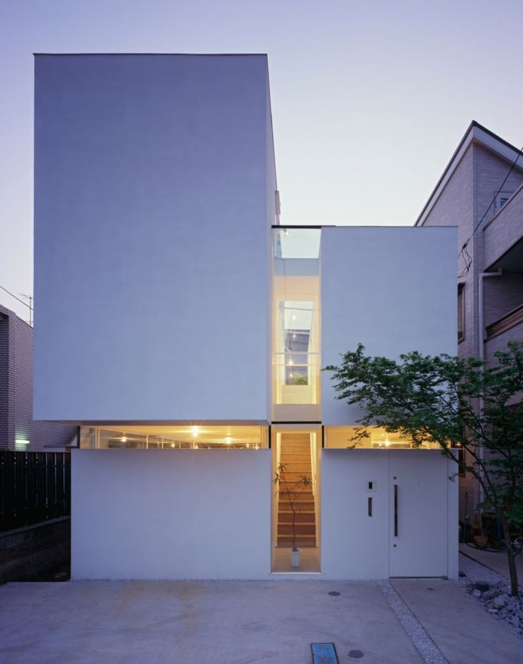 japanese practice tetsushi tominaga architect & associates has sent us images of 'gap house',  a two-storey private residence in the center of tokyo, japan. working with the small and narrow site,  the design incorporates a common space that stretches both horizontally and vertically to loosely  define the interior programs through light chasms in the built volume.