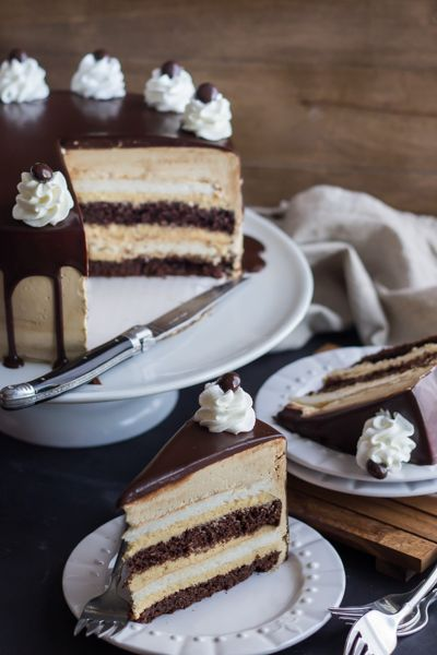 """Salted Caramel Mocha Heaven and Hell Cake Recipe! Oh my gosh... """"Alternating layers of Angel Food Cake and Devils Food Cake are filled with Salted Caramel Mousse, frosted with Espresso Swiss Meringue Buttercream, and glazed with a Decadent Dark Chocolate Ganache."""""""
