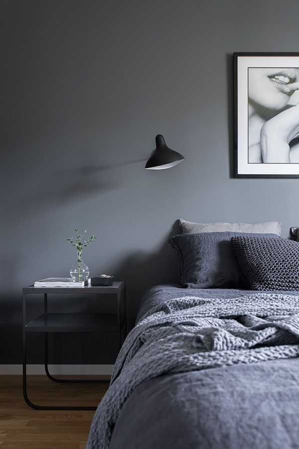 Black bedroom, black bedding and bed side table with lamp