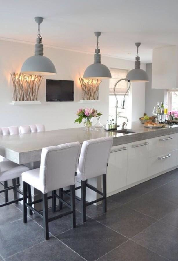In LOVE with this kitchen styling.. extended counter for breakfast bar. Love color palette and details.