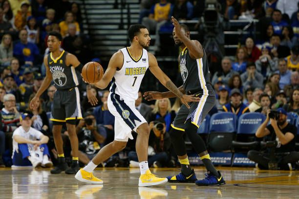 Trey Lyles of the Denver Nuggets is guarded by Kevin Durant of the Golden State Warriors at ORACLE Arena on December 23 2017 in Oakland California...