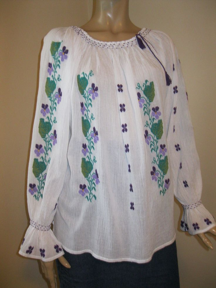 Charming handmade Romanian peasant  blouse, hand embroidered with multicolored cotton / acrylic thread on the finest and  sheer gauze cotton.  For sale at www.greatblouses.com