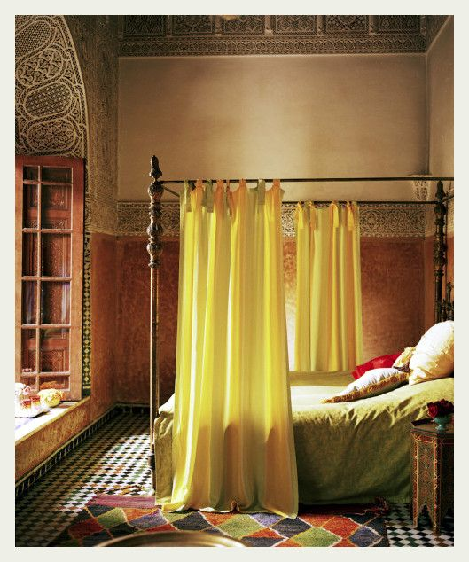 India meets Marrakech in this Handsome Bedroom. Carved Canopy Bed, Silk and Linen Bedding, and Vintage Persian Carpet create a Restful Retreat.