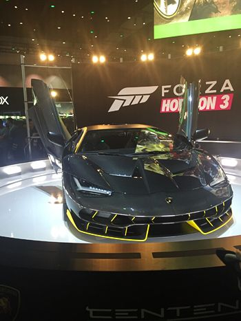 A tricked-out car rotated on a circular platform for Forza Horizon 3.
