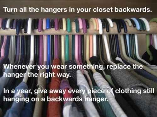 Try this neat hanger trick to figure out which clothes to give away.   53 Seriously Life-Changing Clothing Organization Tips