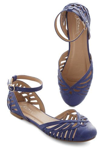 Begin your day by buckling into these royal blue sandals, and you're sure to feel like you're walking on cloud nine! With faux snake-skin texture and a collection of cutouts along the toe and counter, these ankle-strap flats fill each step with merriment.