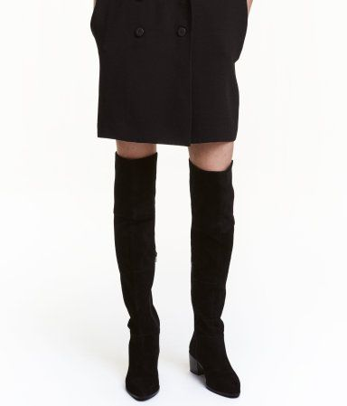 Black. High boots in imitation suede with an elasticized leg section ending just above the knee. Zip at side and covered block heels. Satin lining,