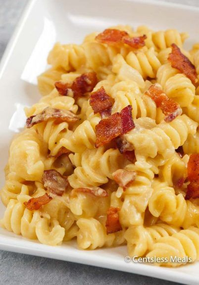 "Beer Cheese Sauce tossed with tender pasta and smoky crisp bacon.  This mac and cheese recipe is going to be a staple in your dinner plans! Like this recipe? ""Pin it"" to save it by clicking the photo above!!  Be sure to follow CentsLessDeals on Pinterest and check out our other great recipes while you're …"