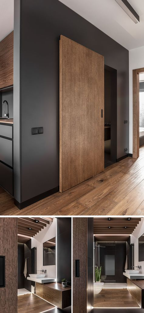 A sliding wooden door characterizes the modern bathroom …