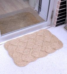 "A traditional knotted jute door mat. Made from 100% natural fibers, this mat is perfect for wiping the mud off your feet after a long day playing outside.     30"" x 18"""