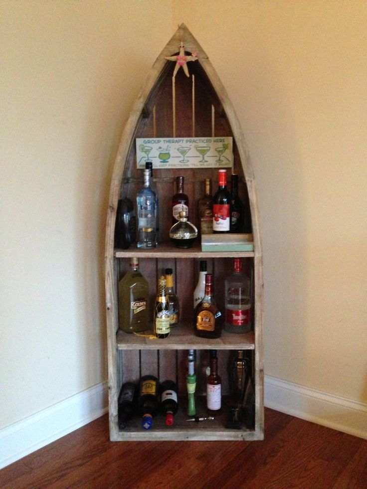 Easy beach bar for shore house!! Used a decorative wooden boat ($50)- cheap and chic!!!!