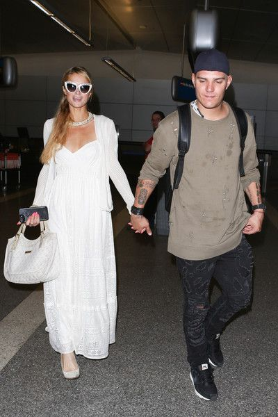 Paris Hilton Maxi Dress - Paris Hilton was spotted at LAX looking boho-sweet in a white maxi dress with a sweetheart neckline.