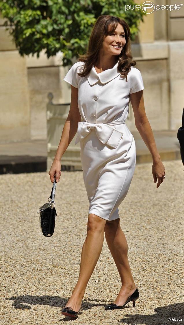 July 14, 2009 - Carla Bruni with Nicolas Sarkozy in Paris, France - in Dior w/ her Miss Viv bag