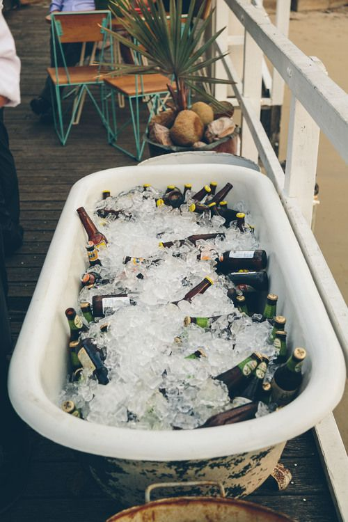 A bathub of beers on ice for a Wedding At The Boathouse Palm Beach | PHOTO CREDIT: Milton Gan Photography | @milton