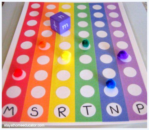 "Rainbow Letter Identification Game - fun letter identification racing game.  Roll a dice with lower-case letters on & match that lower-case letter with it's capital letter to reach the top of the board ("",)"