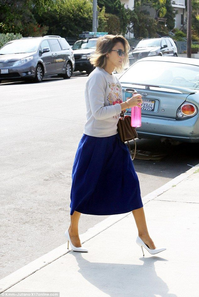 Classy on the coast: Jessica Alba, 33, spotted in a long spring skirt and tiger sweatshirt...