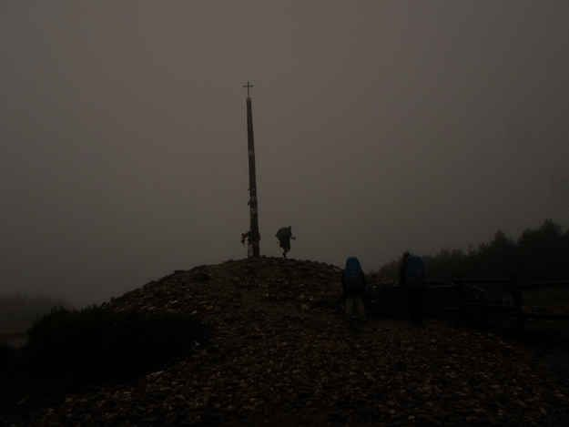 The Misty, Cloud-Covered Cruz de Ferro  | 22 Beautiful Places You Will See On The Camino De Santiago